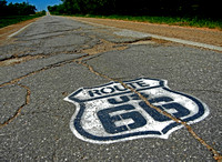 STENCILED 66 SIGN ON SIDEWALK HIGHWAY (Rt 66 nr Narcissa OK)