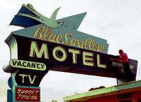 WAXING THE BLUE SWALLOW SIGN (Rt 66 Tucumcari NM)