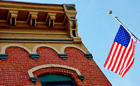 RESTORED BUILDING AND FLAG (Lincoln Highway Fulton IL)
