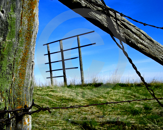 PARTIAL SIGN THROUGH BARBED WIRE FENCE (nr Wall SD)