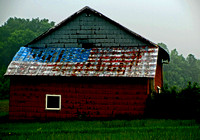 PAINTED FLAG ON BARN ROOF IN RAIN (National Road IL)
